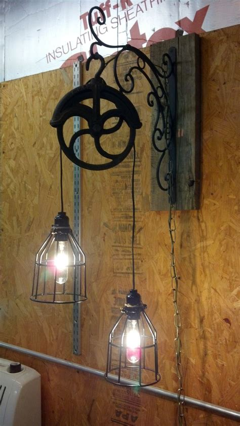 Pulley Light Fixture Light Fixture Made From Pulley Www Bransonvacationrentalcabins Cabin Decor