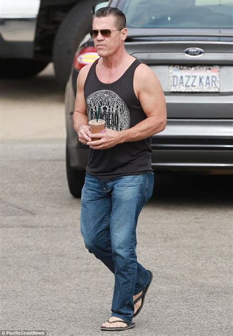 josh brolin shows off muscles while grabbing a smoothie