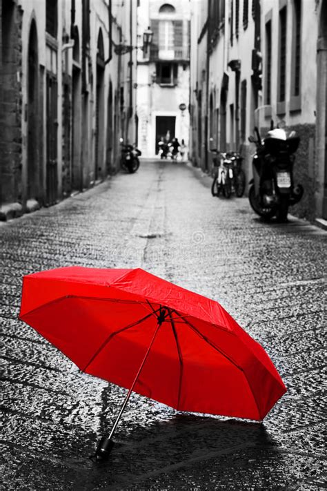 X2 3746 St Umbrella umbrella on cobblestone in the town wind and stock photo image of black
