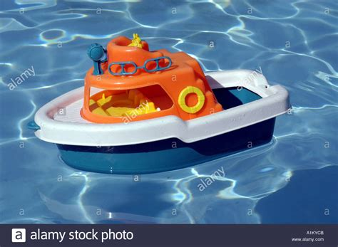 floating boat images colorful toy boat floats in swimming pool stock photo