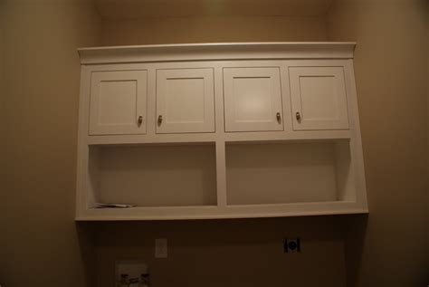 cabinets above washer dryer boss lady s ruminations painting lights and cabinets