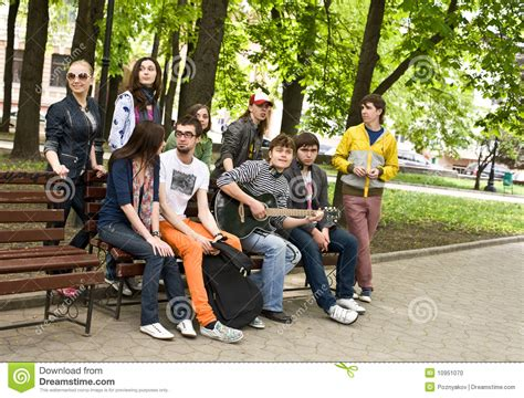 group of peope on bench in park stock photo image 10951070