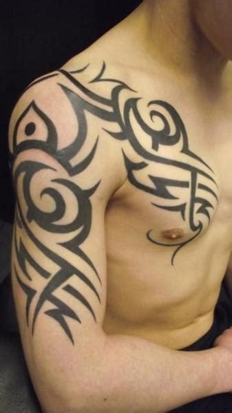 tribal tattoos chest arm shoulder shoulder chest tribal by paul egan