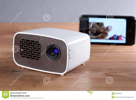 Home Design 3d Compact Download Mini Projector With Smartphone On Wooden Table Stock Photo