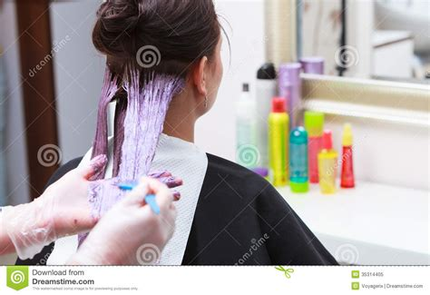hair salons that color hair hairdresser applying color customer at salon doing
