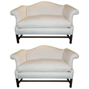 pair of chippendale style camelback sofa or settees
