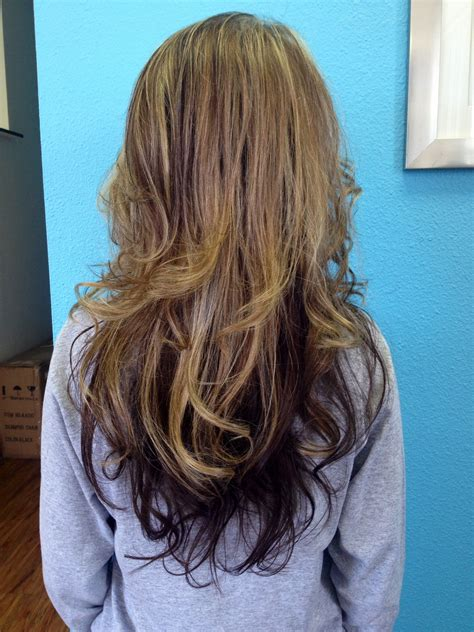 highlight on bottom half of hair heavy blond weave on top left hair brown on bottom half