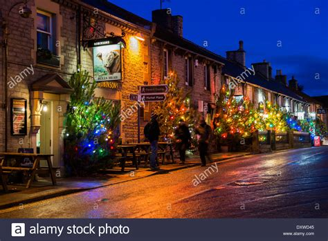 christmas lights and trees illuminate the streets of