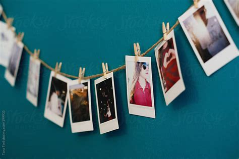how to hang a string of pictures on a wall 13 steps a side view of a string of mini polaroids hanging on a