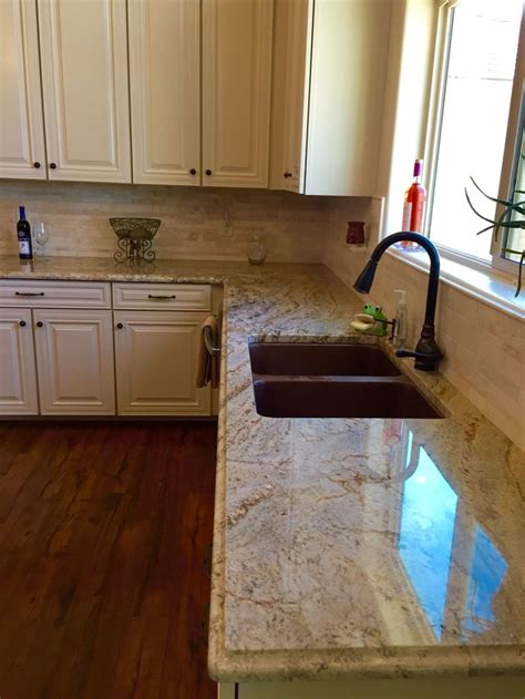 granite countertops and cabinets beautiful hammered copper and typhoon bordeaux