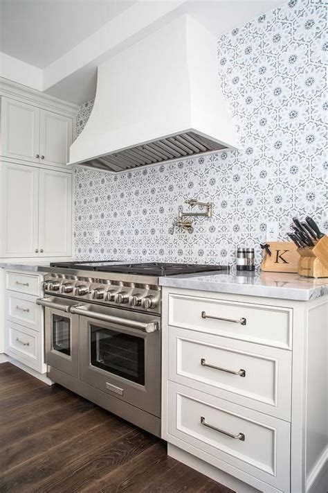 Ivory Shaker Kitchen Cabinets Ivory And Gray Kitchen Features Ivory Shaker Cabinets Paired With Marble Countertops And A Gray