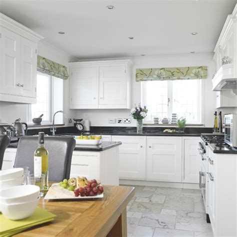 black white and green kitchen white shaker kitchen with green accents housetohome co uk