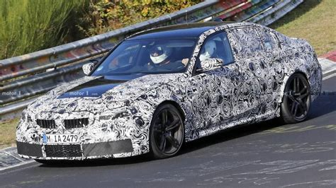 bmw  spied  production headlights