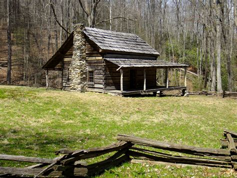 the dug road in cataloochee cabin porch and log cabins