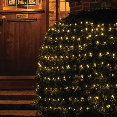 how to attach net lights to hedges give your garden and patio some this year