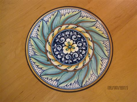 mediterranean kitchen damariscotta my table inlaid with italian tile at l aroma cafe