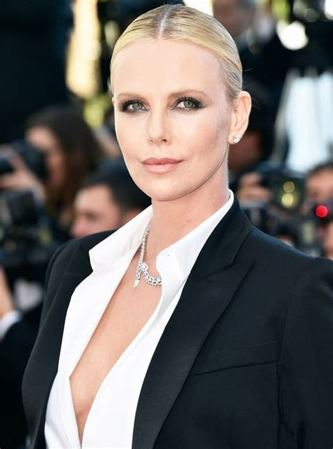 2016 hot charlize theron charlize theron stuns in tuxedo at cannes 2016 red carpet