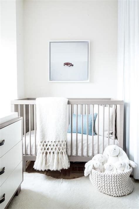 gray rug for nursery neutral nursery decorating ideas parquet wood flooring white cowhide rug and gray crib