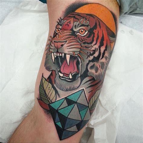 new school geometric tattoo big old school colored roaring tiger on arm tattoo with