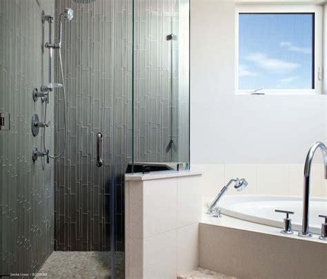 contemporary bathroom showers modern glass tile showers island stone smoke linear glass tile shower with pebble