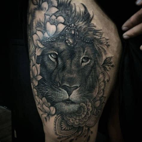 lion blumen realistic lion tattoo with flowers by hendro dewisura