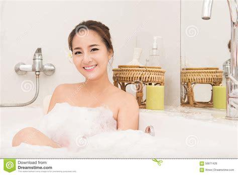 woman bathtub bathing woman relaxing in bath smiling relaxing asian