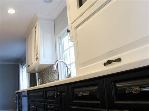 lighted upper kitchen cabinets dark lower cabinets and light upper in kitchen the