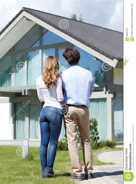 Couple Looking At House Stock Photo Image 56607121