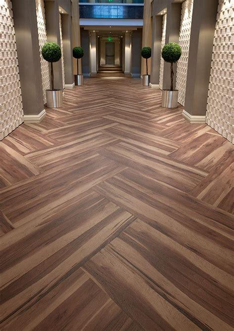 herringbone pattern with vinyl plank hotel corridor featuring affinity255 smoked walnut vinyl