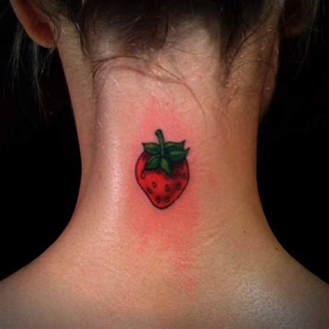 cute strawberry tattoo on her neck