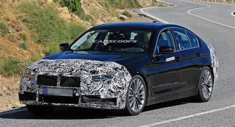 facelifted  bmw  series sedan boasts larger grille