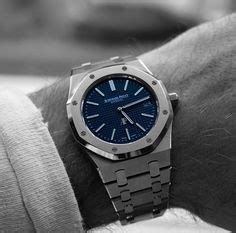 Pasha Cesar 275 Royal Blue updated royal oak 15200st with black datewheel wrist