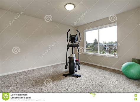 beige interior of small home with sport equipment