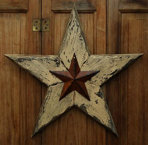 idea for wood metal mix decorations primitive distressed wood 15 inch rusty tin barn star