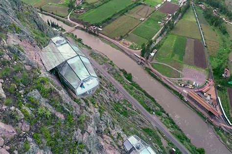 400 Feet by Transparent Sleeping Pods Dangling From Side Of Cliff