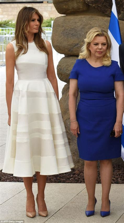 melania trump does an change for italy arrival