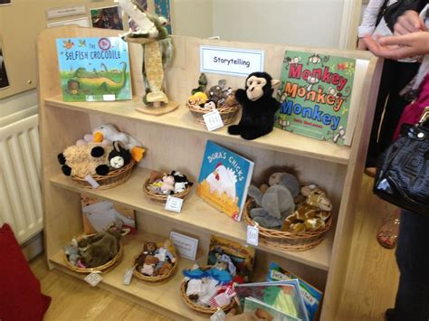 story themes for early years book area with play props to support imaginative play and