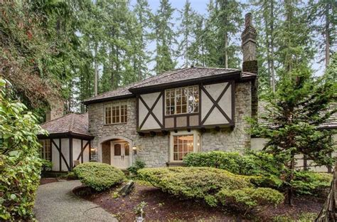 tudor style homes for sale with crumbling wall theme