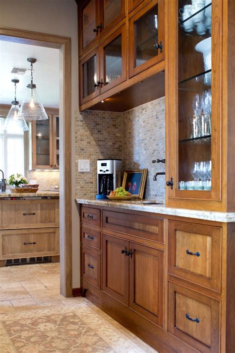 is the wood trim on the door the same white wash on the cabinets in the background