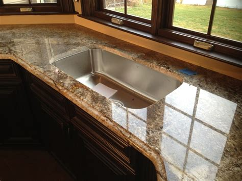 Hanging Lights Over Kitchen Island by Aj Brown Granite Countertops With Ogee Edge On Kitchen And