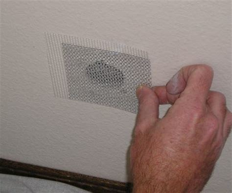 Fix Hole In Wall by How To Repair A Medium Drywall Hole The Practical House