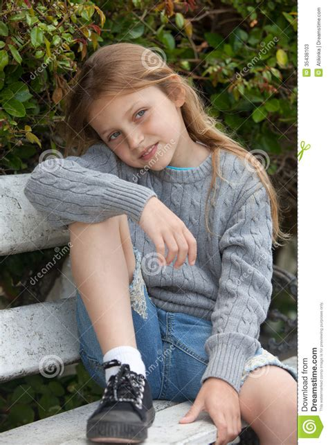 girl bench happy girl sitting on the bench stock photos image 35438103