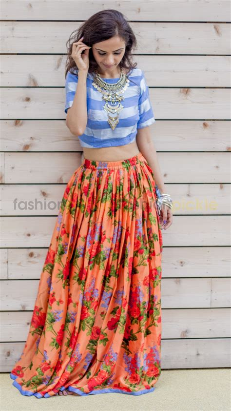 Expand Floral Print Blouse Oranye orange and blue pleated skirt with blue blouse