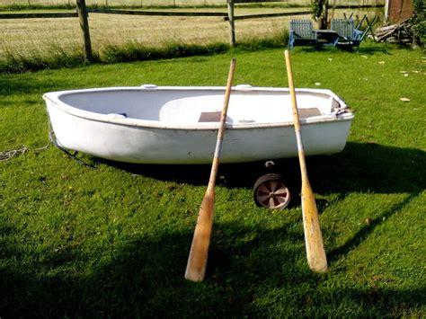small boat oars rowing boat with little trailer and oars in newport