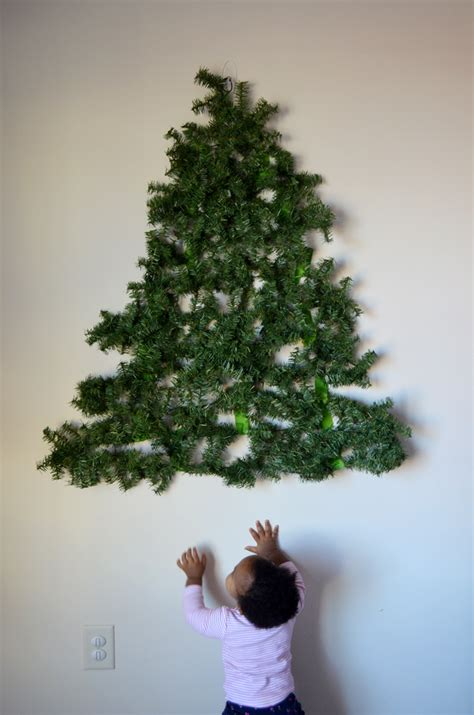 where to put a christmas tree with a fireplace a baby put a diy tree on the wall