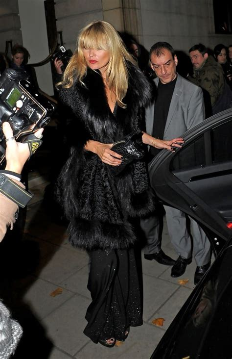 Kate Moss Causes Frenzy At Londons Topshop by Kate Moss Wears A Fur Shawl Clothes Livingly