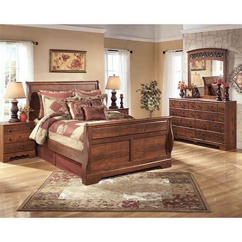 7 piece queen bedroom set rent an ashley timberline 7 piece queen bedroom set