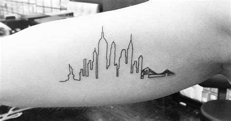 nyc tattoo regulations new york skyline tattoo on the right inner arm