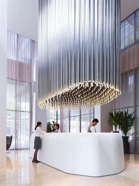 hotel light installation light installation at studio m hotel reception in singapore creative design interiors