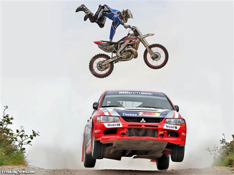 motorcycle over man motorcycle jumping over a rally car pictures